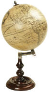 Honey colored world globe on desk base