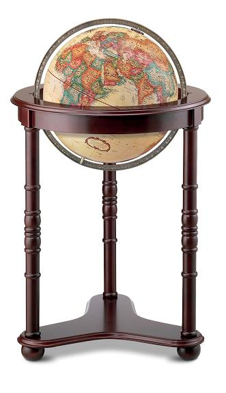 Large world globe on wooden floor stand