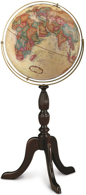 beige world globe on wooden floor pedestal